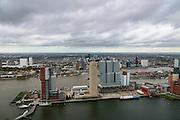 Nederland, Zuid-Holland, Rotterdam, 23-10-2013; Kop van Zuid met Rijnhaven. Op de Wilhelminakade (vlnr) Hotel New York, Montevideo, Las Palmas (het lage witte gebouw, met NFM, Nederlands fotomuseum), New Orleans, en het blauwgrijze gebouw De Rotterdam (verticale stad van OMA/Rem Koolhaas). <br /> Verder de Toren op Zuid en het Nieuwe Luxor Theater.<br /> Nieuwe Maas met binnenstad Rotterdam met skyline in de achtergrond.<br /> <br /> luchtfoto (toeslag op standard tarieven);<br /> aerial photo (additional fee required);<br /> copyright foto/photo Siebe Swart