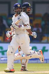 August 3, 2017 - Colombo, Sri Lanka - Indian cricketers Cheteshwar Pujara(R) and Ajinkya Rahane run between the wickets during the 1st Day's play in the 2nd Test match between Sri Lanka and India at the SSC international cricket stadium at the capital city of Colombo, Sri Lanka on Thursday 03 August 2017. (Credit Image: © Tharaka Basnayaka/NurPhoto via ZUMA Press)