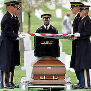 Members of the U.S. Army Casket Team stand at attention straightening the American flag over the Casket of Peter G. Enos who perished in Iraq at his burial at Arlington National Cemetary.  Army Spc. Peter G. Enos 24, of South Dartmouth, Mass.; assigned to 1st Battalion, 7th Field Artillery Regiment, 1st Infantry Division, in Schweinfurt, Germany; killed April 9 when a rocket-propelled grenade struck his patrol vehicle in Bayji, Iraq.