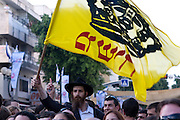 Israel, Tel Aviv, Dizengoff Square, Chanad religious man waving the yellow Messiah flag