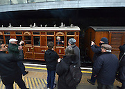 © Licensed to London News Pictures. 13/01/2013. London, UK London Mayor Boris Johnson looks out of a carriage window as he travels through Earls Court aboard the special service. Crowds at Earls Court Underground station as it welcomes the newly restored Met steam Locomotive No. 1 back to the Underground today, 13th January 2013, on the original stretch of the Metropolitan line. This is to mark the 150th anniversary of the opening of the world's first underground in January 1863. The Metropolitan Railway 'Jubilee' Carriage No. 353, recently restored by the Ffestioniog Railway. The Chesham set of Metropolitan Railway Bogie stock coaches (1898-1900), the Metropolitan Railway Milk Van No. 3 (1896) were all pulled by Met No 1 (built 1898) which provided the motive power at the front of the train. Photo credit : Stephen Simpson/LNP