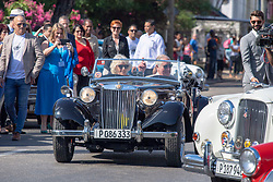 The Prince of Wales and the Duchess of Cornwall ride in an MG TD sportscar from 1953 as they arrive at a British Classic Car event in Havana, Cuba, as part of an historic trip which celebrates cultural ties between the UK and the Communist state.