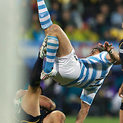 Horacio Agulla, Argentina, is sent airborne as he collides with Sean Lamont, Scotland, during the Argentina V Scotland, Pool B match at the IRB Rugby World Cup tournament. Wellington Regional Stadium, Wellington, New Zealand, 25th September 2011. Photo Tim Clayton...