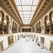 Wide-angle shot of the main hall at the Royal Museums of Fine Arts in Belgium (in French, Musées royaux des Beaux-Arts de Belgique), one of the most famous museums in Belgium. The complex consists of several museums, including Ancient Art Museum (XV - XVII century), the Modern Art Museum (XIX  XX century), the Wiertz Museum, the Meunier Museum and the Museé Magritte Museum.