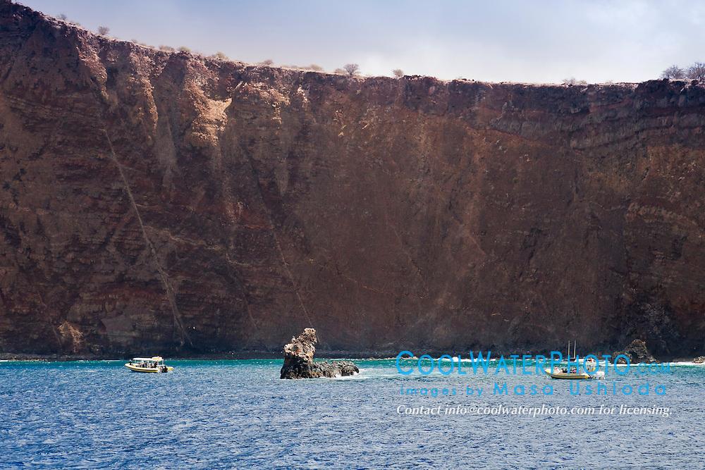 Moku Naio aka Shark Fin Rock, a popular dive site, Kaholo Pali sea cliff , 194 feet (59.13m) high, South Lāna'i, Lāna'i aka Pineapple Island because of its past as an island-wide pineapple plantation of Dole, the sixth-largest island of the Hawaiian Islands, Hawaii, USA, Pacific Ocean