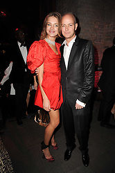 NATALIA VODIANOVA and JUSTIN PORTMAN  at The Love Ball hosted by Natalia Vodianova and Lucy Yeomans to raise funds for The Naked Heart Foundation held at The Round House, Chalk Farm, London on 23rd February 2010.