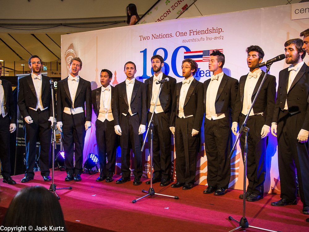 """19 JULY 2013 - BANGKOK, THAILAND: The Yale Whiffenpoofs, one of the best-known collegiate a cappella groups in the world performed in CentralWorld in Bangkok Friday. Founded in 1909, the """"Whiffs"""" began as a senior quartet that met for weekly concerts at Mory's Temple Bar, the famous Yale tavern. The Bangkok stop was a part of their 2013 world tour and was sponsored by the US Embassy. They sang at the opening of a photo exhibit that marked 180 years of friendly diplomatic relations between Thailand and the United States.     PHOTO BY JACK KURTZ"""