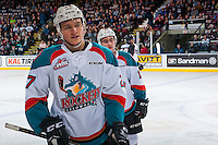 KELOWNA, CANADA - FEBRUARY 10: Calvin Thurkauf #27 of the Kelowna Rockets skates to the bench to celebrate a goal against the Vancouver Giants  on February 10, 2017 at Prospera Place in Kelowna, British Columbia, Canada.  (Photo by Marissa Baecker/Shoot the Breeze)  *** Local Caption ***