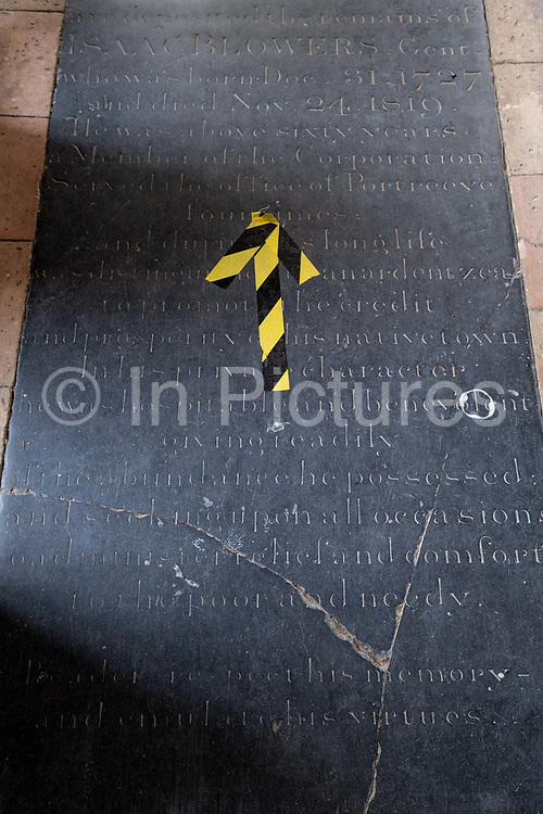 Social distancing hazard tape is on historical  flagstones in the nave of St. Michaels C of E church, during the Coronavirus pandemic, on 13th August 2020, in Beccles, Suffolk, England.