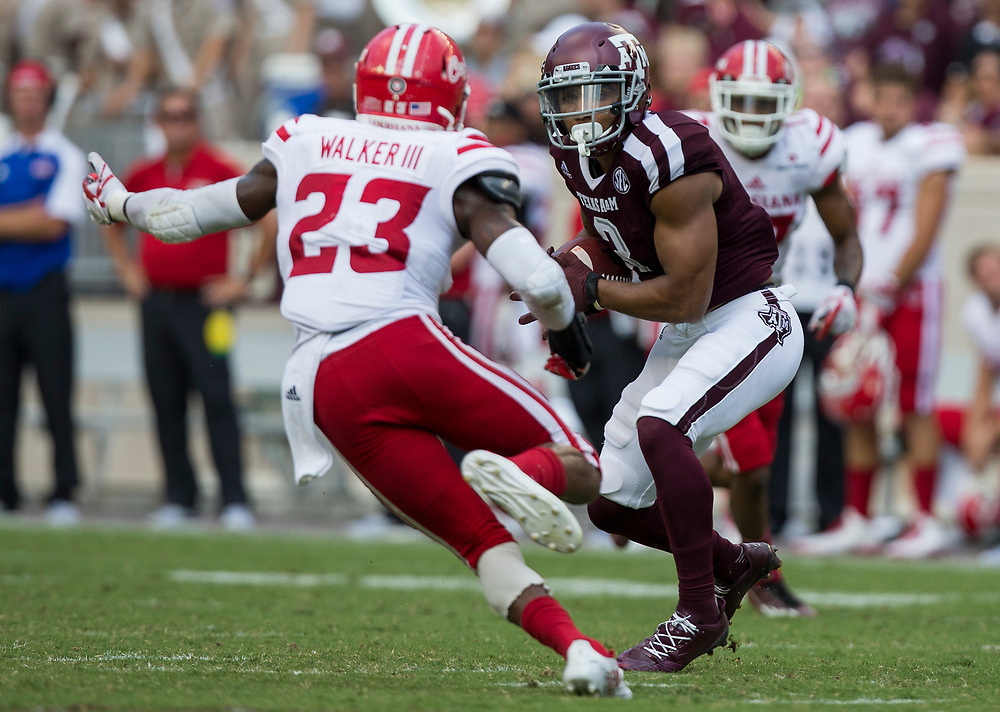 Texas A&M wide receiver Christian Kirk (3) looks to run up field after a catch against Louisiana-Lafayette defensive back Tracy Walker (23) during the third quarter of an NCAA college football game Saturday, Sept. 16, 2017, in College Station, Texas. (AP Photo/Sam Craft)
