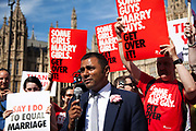 Lord Ali, Labour, speaks to the crowd. The bill 'Marriage Bill 2012-13 to 2013-14'<br /> (Same Sex Couples)  has just been passed in the House of Lords to great joy for supporters outside Parliament. The bill is to to make provision for the marriage of same sex couples in England and Wales, about gender change by married persons and civil partners, about consular functions in relation to marriage, for the marriage of armed forces personnel overseas, and for connected purposes.