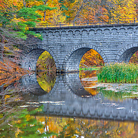 Wachusett Aqueduct Bridge framed by beautiful New England fall foliage reflecting in the Assabet River Reservoir in Northborough, Massachusetts on a brisk autumn day. <br /> <br /> Massachusetts fall foliage and Wachusett Aqueduct Bridge photography images are available as museum quality photo, canvas, acrylic, wood or metal prints. Wall art prints may be framed and matted to the individual liking and interior design decoration needs:<br /> <br /> https://juergen-roth.pixels.com/featured/wachusett-aqueduct-bridge-juergen-roth.html<br /> <br /> Good light and happy photo making!<br /> <br /> My best,<br /> <br /> Juergen<br /> Licensing: http://www.rothgalleries.com<br /> Photo Prints: http://fineartamerica.com/profiles/juergen-roth.html<br /> Photo Blog: http://whereintheworldisjuergen.blogspot.com<br /> Instagram: https://www.instagram.com/rothgalleries<br /> Twitter: https://twitter.com/naturefineart<br /> Facebook: https://www.facebook.com/naturefineart