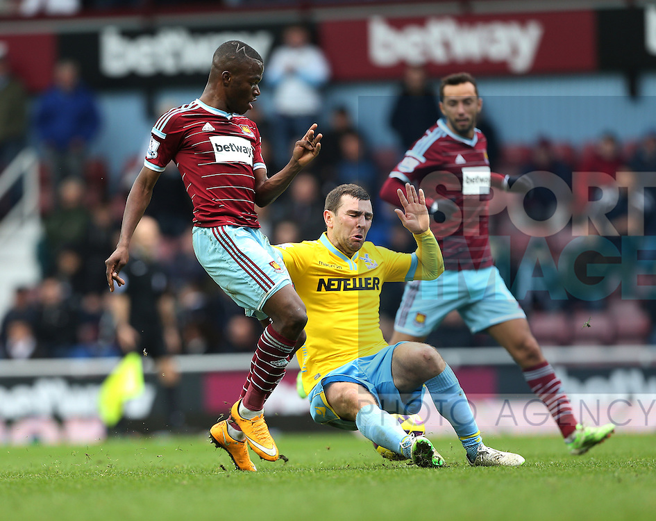 West Ham's Enner Valencia tussles with Crystal Palace's James MCarthur<br /> <br /> Barclays Premier League - West Ham United  vs Crystal Palace  - Upton Park - England - 28th February 2015 - Picture David Klein/Sportimage