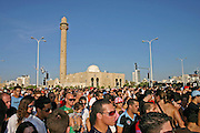 Israel Tel Aviv, crowds at the Tel Aviv Love Parade October 2005, Hasan Beq mosque can be seen in the background