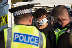 Hertfordshire Police arrest an environmental activist from HS2 Rebellion who, together with another activist, had used a lock-on arm tube to block a gate to the South Portal site for the HS2 high-speed rail link on 14 September 2020 in West Hyde, United Kingdom. Anti-HS2 activists blocked two gates to the same works site for the controversial £106bn rail link, one remaining closed for over six hours and another for over nineteen hours.