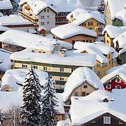 Snowy rooftops in the town of Andrematt, Switzerland, after a heavy winter snowfall.<br /> <br /> LICENSING: This image can only be licensed through SpacesImages. Click on the link below:<br /> <br /> http://tinyurl.com/bnkep8c