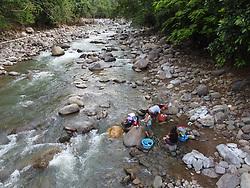 Women wash clothes in the Guapinol river, Colon, Honduras.