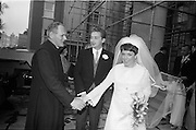 """16/09/1967<br /> 09/16/1967<br /> 16 September 1967<br /> Wedding of Mr Francis W. Moloney, 28 The Stiles Road, Clontarf and Ms Antoinette O'Carroll, """"Melrose"""", Leinster Road, Rathmines at Our Lady of Refuge Church, Rathmines, with reception in Colamore Hotel, Coliemore Road, Dalkey. Image shows the Bride and Groom being congratulated by an unknown clergyman after the ceremony."""