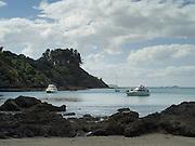 View of Mawhitipana Bay, Waiheke Island, New Zealand. moored boats.