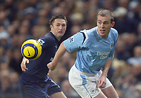 11/12/2004 - FA Barclays Premiership - Manchester City v Tottenham Hotspur - The City of Manchester Stadium.<br />Manchester City's Richard Dunne and Tottenham Hotspur's Robbie Keane are both deceived by the bouncing ball.<br />Photo:Jed Leicester/Back Page Images