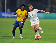 Beijing, CHINA.   Olympic Football, Women's Gold  Medal Game, USA vs BRA,  left Brazils, ESTER, and right, USA's. Heather O'REILLY, running through, at the Beijing Workers Stadium. Thursday,  21.08.2008 [Mandatory Credit: Peter SPURRIER, Intersport Images]