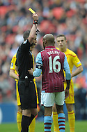 Referee Michael Oliver books Fabian Delph, the Aston Villa captain  for a foul. The FA Cup, semi final match, Aston Villa v Liverpool at Wembley Stadium in London on Sunday 19th April 2015.<br /> pic by John Patrick Fletcher, Andrew Orchard sports photography.