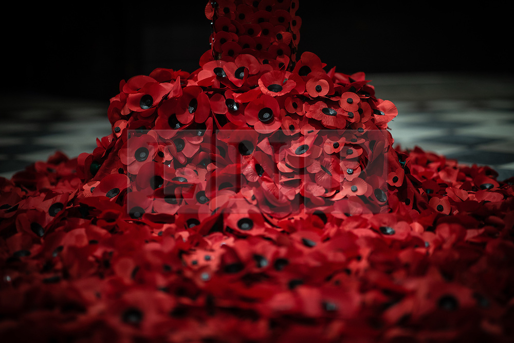 © Licensed to London News Pictures. 11/11/2018. Manchester, UK. A cascade of poppies on the floor at the base of a poppy cross , created by Manchester Cathedral flower arranger Helen Bamping at Manchester Cathedral on the morning of the 100th anniversary of Armistice Day , marking the end of the First World War . Photo credit: Joel Goodman/LNP