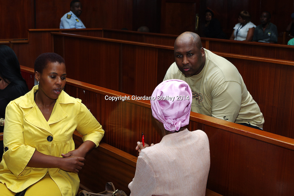 DURBAN - 25 September 2014, Former Blue Bulls rugby player Phindile Joseph Ntshongwana who stands accused of killing four people with an axe, trying to kill two others, raping another and assaulting another person speaks to his sister Luleka Ntshongwana (left) and his mother mother Phylina Letlaka in the Durban High Court where Acting Judge Irfaan Khalil was delivering his judgement. Picture: Allied Picture Press/APP