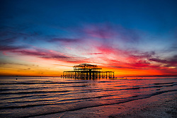 © Licensed to London News Pictures. 17/11/2017. Brighton, UK. A colourful sky hangs over Brighton and Hove at sunset, today 17th November 2017. Photo credit: Hugo Michiels/LNP