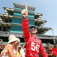 27 May, 2012, Indianapolis, Indiana, USA<br /> Dario Franchitti waves to the fans before taking a victory lap with wife Ashley and Susie Wheldon, widow of Dan Wheldon.<br /> (c)2012, Phillip Abbott<br /> LAT Photo USA