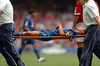 Picture: Henry Browne.Digitalsport<br /> Date: 08/08/2004.<br /> Arsenal v Manchester United FA Community Shield.<br /> <br /> Jeremie Aliadiere gets stretchered off during the second half.