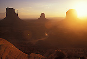 Sunrise, West & East Mitten Buttes & Merrick Butte, Navajo Tribal Park, Arizona.©1996 Edward McCain. All rights reserved. McCain Photography, McCain Creative, Inc..