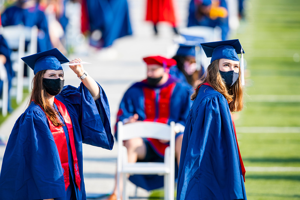 Graduates and faculty participate in the rescheduled May Commencement for the Graduation Class of 2020, Saturday, August 15, 2020 at Gerald J. Ford Stadium on the SMU Campus.
