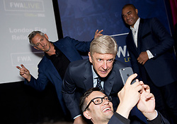 (left to right) Gary Lineker, Arsene Wenger, and Paul Elliot take a selfie with a fan during the Football Writers Association Live event at Ham Yard Hotel, London.