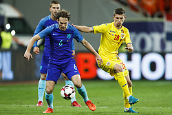 (l-r) Daley Blind of Holland, Florin Tanase of Romania during the friendly match between Romania and The Netherlands on November 14, 2017 at Arena National in Bucharest, Romania