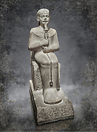 """Ancient Egyptian statue of Ptah - limestone - New Kingdom. 18th Dynasty, reign of Amenhotep III (1390 - 1353 BC), Karnac. Egyptian Museum, Turin.  <br /> <br /> Large statue of Egyptian gods are rare and most of them are part of building designs. This imposing statue of Ptah was probably made for the """"Temple of Millions of Years"""", on the west bank of Thebes, promoted by Amenhotep III . When the temple was eventually abandoned its statues were reused in other temples in the region. Drovetti collection C. 87 .<br /> <br /> Visit our HISTORIC WALL ART PRINT COLLECTIONS for more photo prints https://funkystock.photoshelter.com/gallery-collection/Historic-Antiquities-Photo-Wall-Art-Prints-by-Photographer-Paul-E-Williams/C00002uapXzaCx7Y<br /> <br /> Visit our Museum ART & ANTIQUITIES COLLECTIONS to browse more photo at: https://funkystock.photoshelter.com/p/museum-antiquities"""