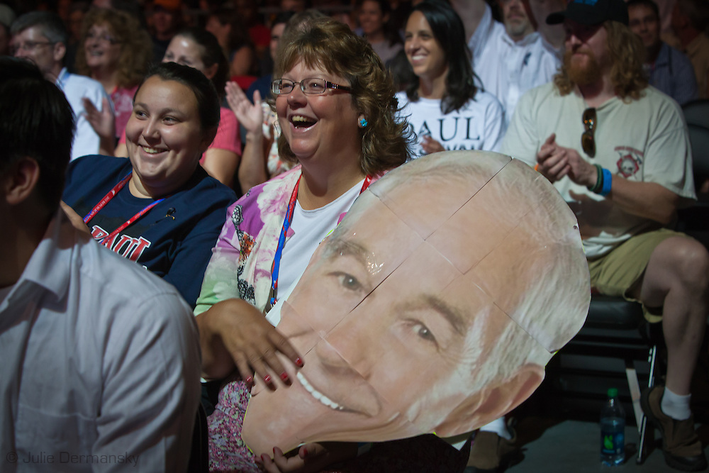 August 26, 2012, Tampa Florida, Mary White, a Ron Paul supproter from Rathdrum Idaho holds a giant Ron Paul Head in University of South Florida's Sun Dome during the Ron Paul Rally. Ron Paul held a rally preceding the RNC in Tampa for his supporters and delegates.
