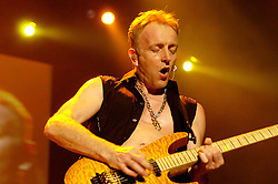 Def Leppard play thier home town of Sheffield at the Hallam FM Arena one of only two UK dates - Phil Collen..17 June 2006.Copyright Paul David Drabble