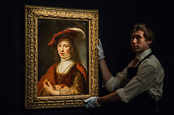 """© Licensed to London News Pictures. 04/12/2015. London, UK. A technician presents """"A tronie of a young woman"""" by Govert Flinck (est. £0.2-0.3 million) ahead of Sotheby's London evening sale of Old Master and British paintings on 9th December 2015.  Photo credit : Stephen Chung/LNP"""