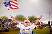 12 JUNE 2010 - PHOENIX, AZ: Dorothy Hall (CQ) from Phoenix, AZ, cheers for former Congressman Tom Tancredo (R-CO) (CQ) during his speech in support of SB 1070 at Bolin Memorial Park near the State Capitol in Phoenix Saturday. About 500 people, many from California and Florida, attended the afternoon rally. PHOTO BY JACK KURTZ