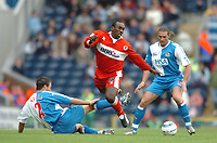 Photo: Back Page Images. 16/10/2004.<br /> Barclays Premiership. Blackburn Rovers v Middlesbrough. Ewood Park.<br /> <br /> <br /> <br /> <br /> Jimmy Floyd Hasselbaink is tackled by Lucas Neill