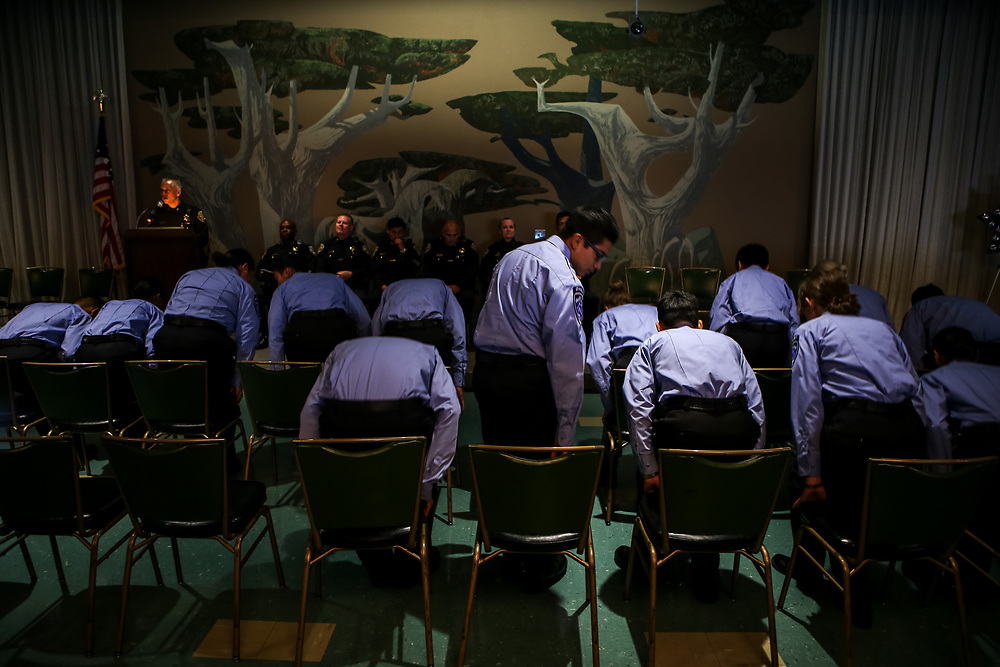 Police Activities League cadets take a seat during their graduation at the Scottish Rite Masonic Center in San Francisco, Calif., Friday, July 8, 2016. Attendees took a moment of silence in response to a shooting the night before in Dallas, Texas that left five police officers dead.