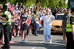 Olympic Torch reaches Sheffield Chapeltown/Ecclesfield/Parson Cross leg.<br /> Runner 102 Joshua McGill brings the flame into chapeltown<br /> 25 June 2012.Image © Paul David Drabble