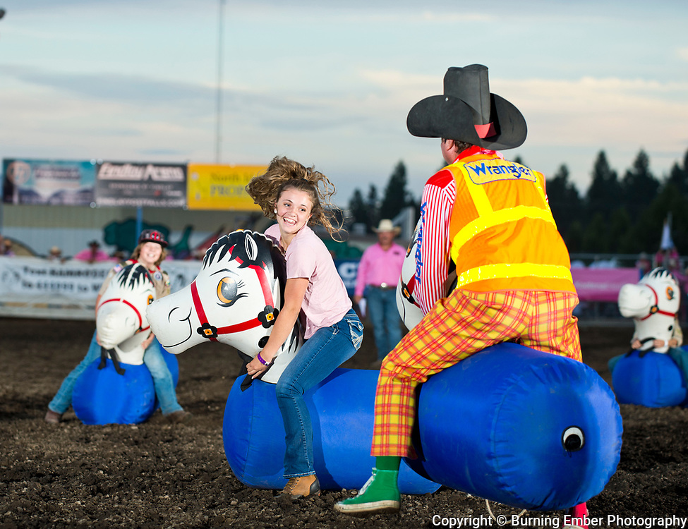 The 4-H kids take on Gizmo in a bouncy horse horse at the Gem State Stampede Pro Rodeo 1st Perf event August 23rd 2019.  Photo by Josh Homer/Burning Ember Photography.  Photo credit must be given on all uses.