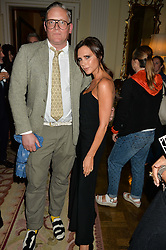 VICTORIA BECKHAM and GILES DEACON at a party to kick off London Fashion Week hosted by US Ambassador Matthew Barzun and Mrs Brooke Brown Barzun with Alexandra Shulman in association with J.Crew hrld at Winfield House, Regent's Park, London on 18th September 2015.