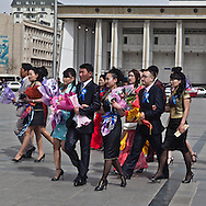 Mongolia. Ulaanbaatar. celebration of the end of university, student celebrationg  on Sukhe bator square, the city center of  Ulaanbaatar. ,  in front of the parliament building that houses a grand statue of Genghis Khan. mongolia