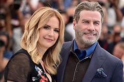 File photo - Kelly Preston and John Travolta posing at the Rendezvous With John Travolta photocall held at the Palais des Festivals on May 15, 2018 in Cannes, France as part of the 71st annual Cannes Film Festival. Kelly Preston, the actress married to John Travolta, has died after a private battle with breast cancer, aged 57. The actress had been battling against breast cancer for two years, with a family representative confirming news of her passing to People today. Photo by Lionel Hahn/ABACAPRESS.COM