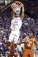 Kansas State's Mario Taybron (22) dunks the ball over Kenton Paulino (12) of Texas, during the second half at Bramlage Coliseum in Manhattan, Kansas, February 22, 2006.  The 7th ranked Longhorns held on for a 65-64 win over K-State.