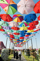 Covered walkway with umbrellas at Miracle Garden in Dubai UAE, Opened in March 2013 and claimed to World's largest flower garden