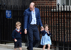 The Duke of Cambridge with Prince George and Princess Charlotte arriving at the Lindo Wing at St Mary's Hospital in Paddington, London where the Duke's third child was born on Monday.